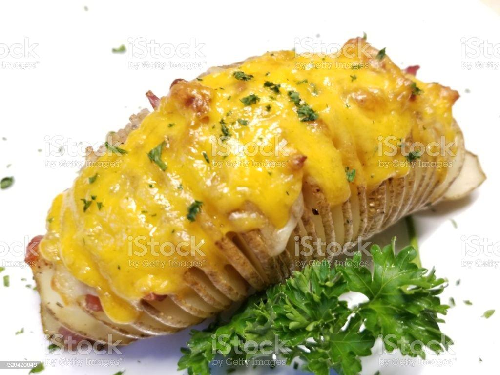 Batata assada com queijo Cheddar - foto de acervo