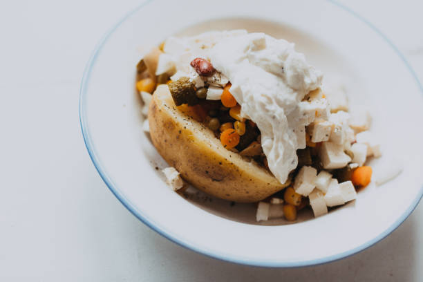 Incredible Baked Potato With Cottage Cheese And Side Dishes Stock Photo Download Free Architecture Designs Scobabritishbridgeorg