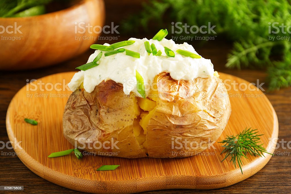 Baked potato with cream of the cream cheese closeup. stock photo