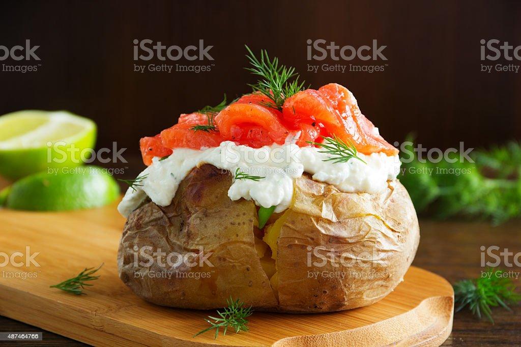 Baked potato with cream stock photo