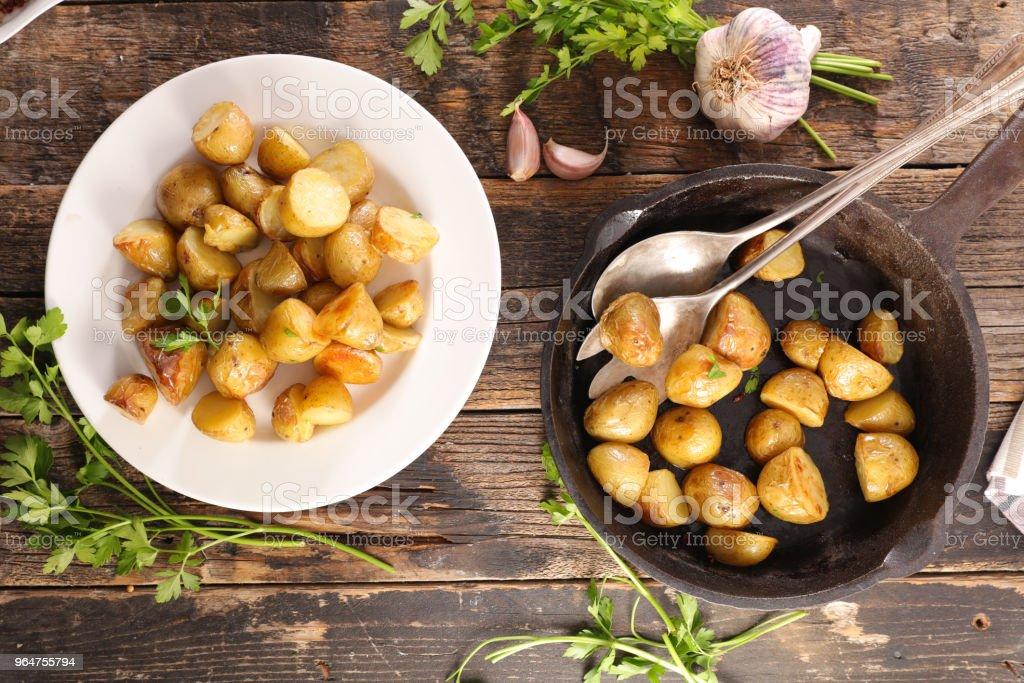 baked potato with herbs royalty-free stock photo