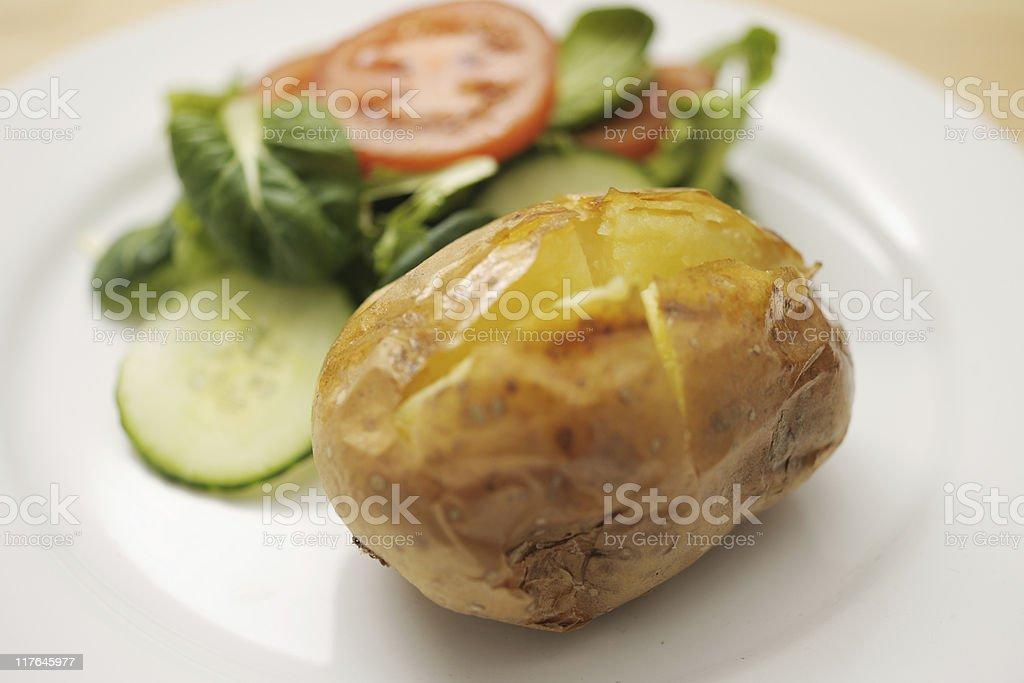 baked potato with salad royalty-free stock photo