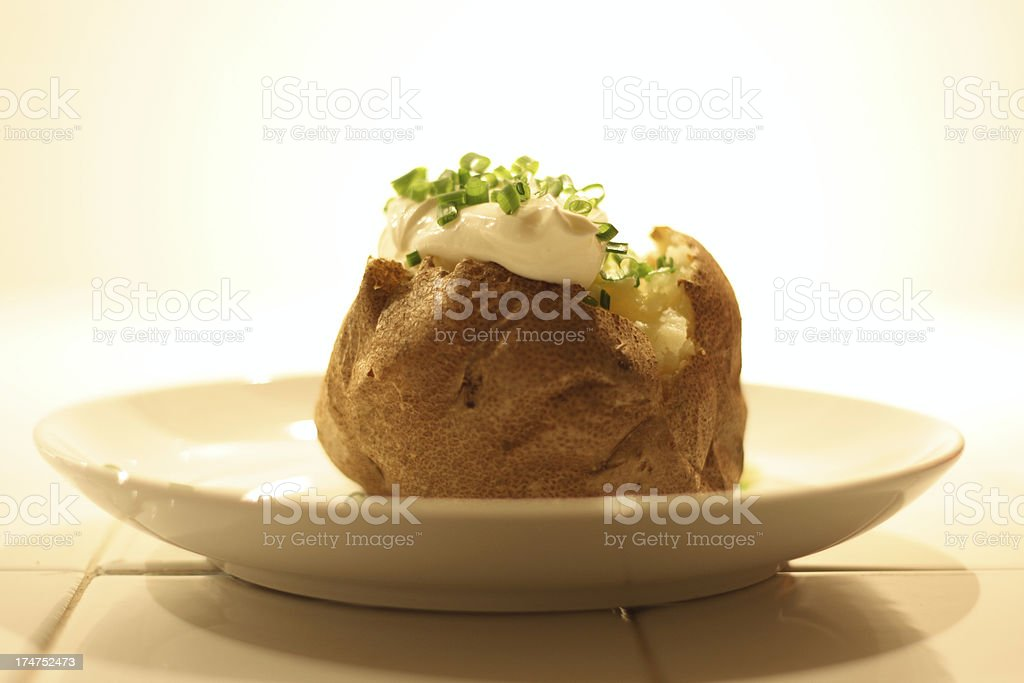 Baked Potato with Sour Cream and Chives royalty-free stock photo