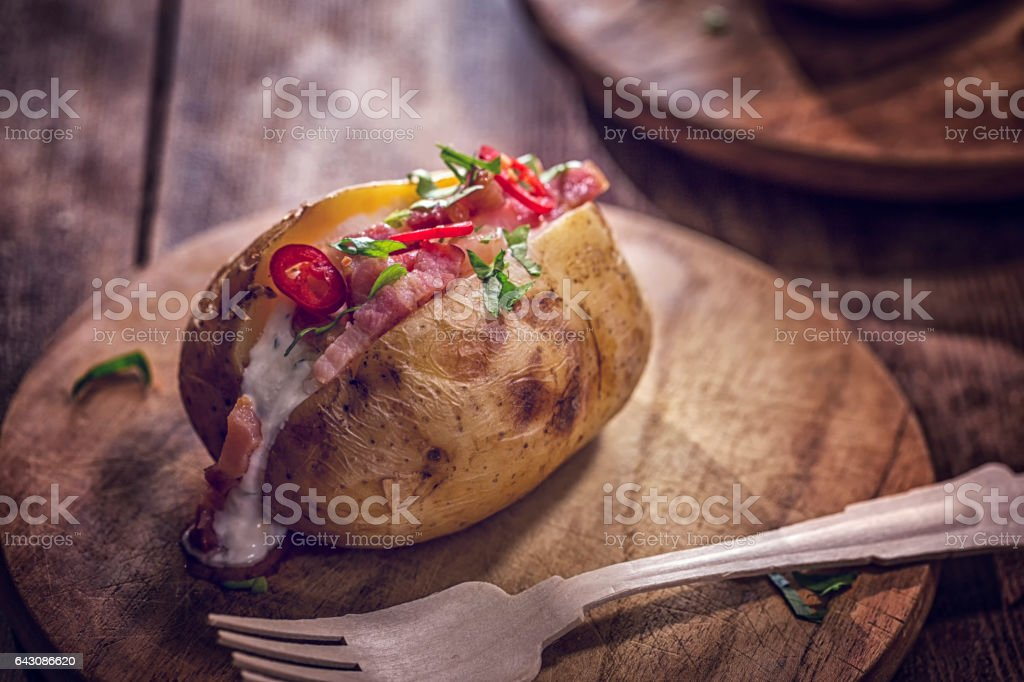 Baked Potato with Sour Cream, Bacon and Chili stock photo