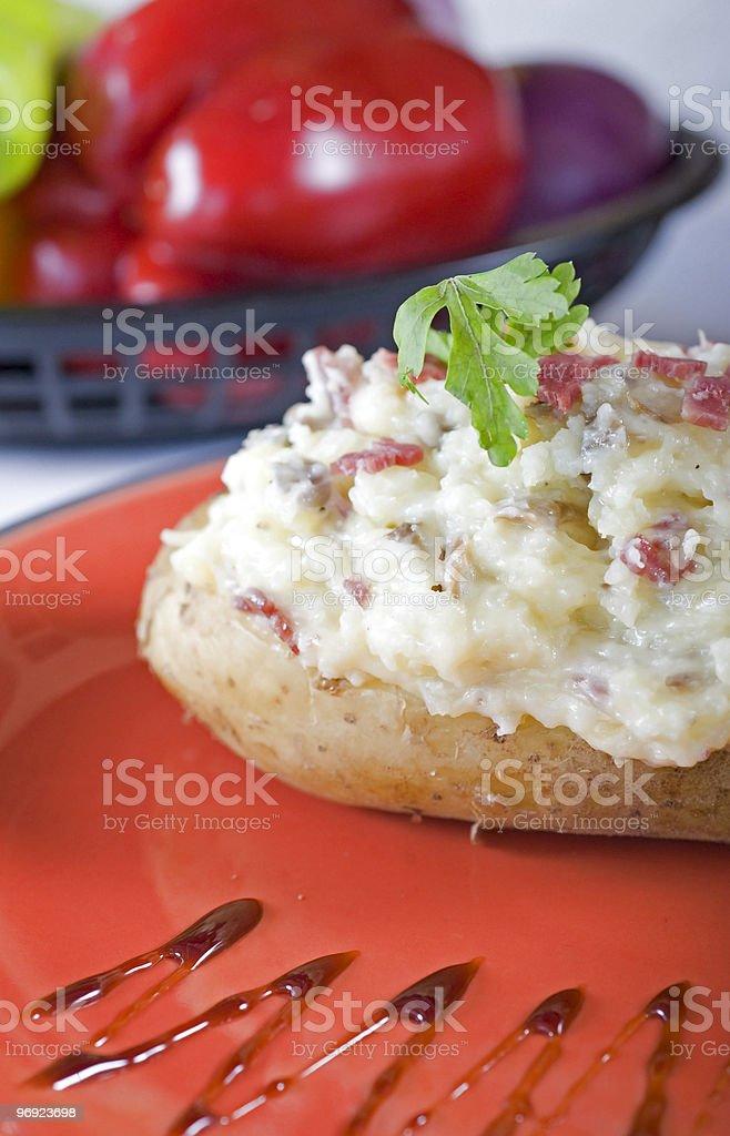 Baked potato with sour cream royalty-free stock photo