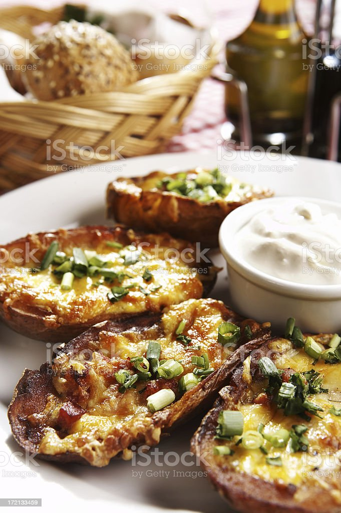 Baked potatoes stuffed with cheese and bacon royalty-free stock photo