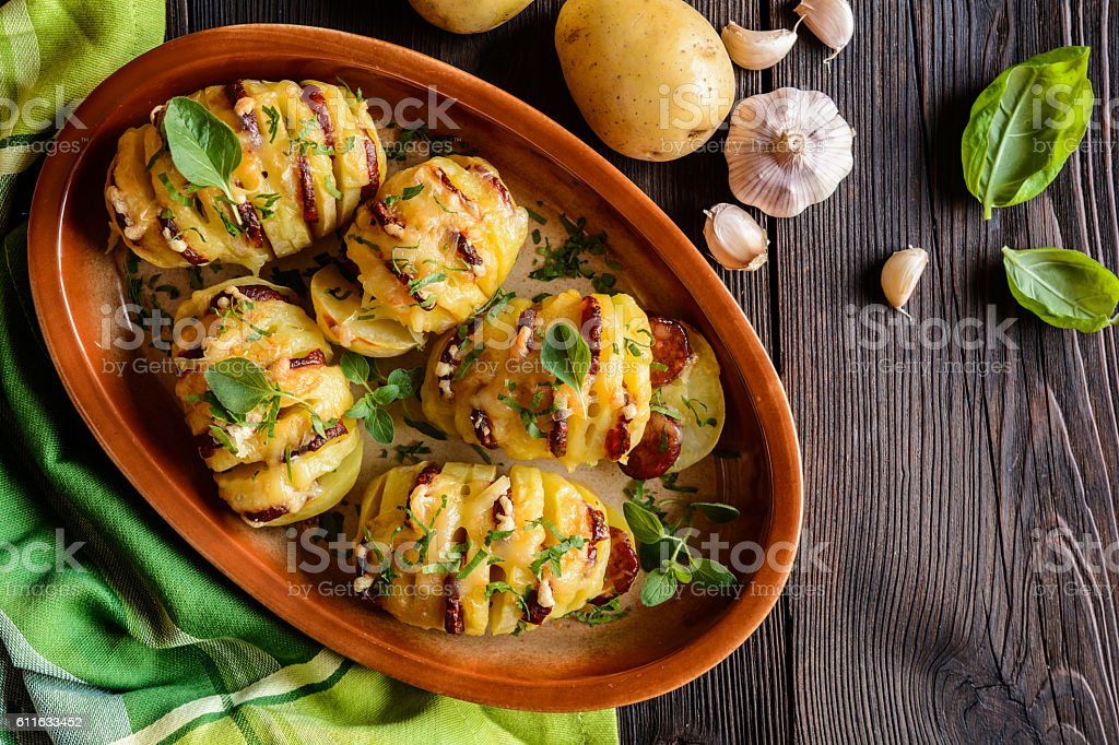 Baked potatoes stuffed with sausage, cheese, garlic and herbs stock photo