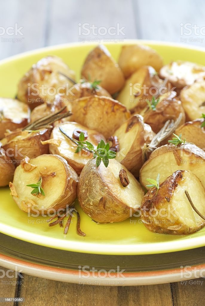 Baked potatoes with garlic and herbs royalty-free stock photo