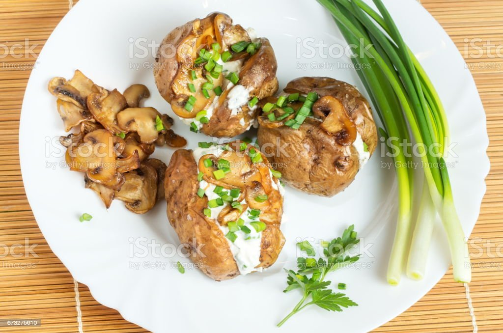 Baked potatoes with mushrooms royalty-free stock photo