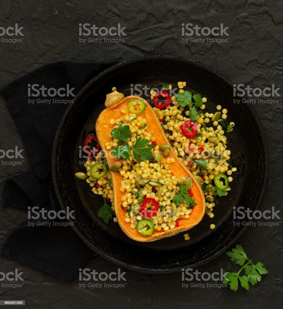 Baked pumpkin stuffed with salad from bulgur. royalty-free stock photo