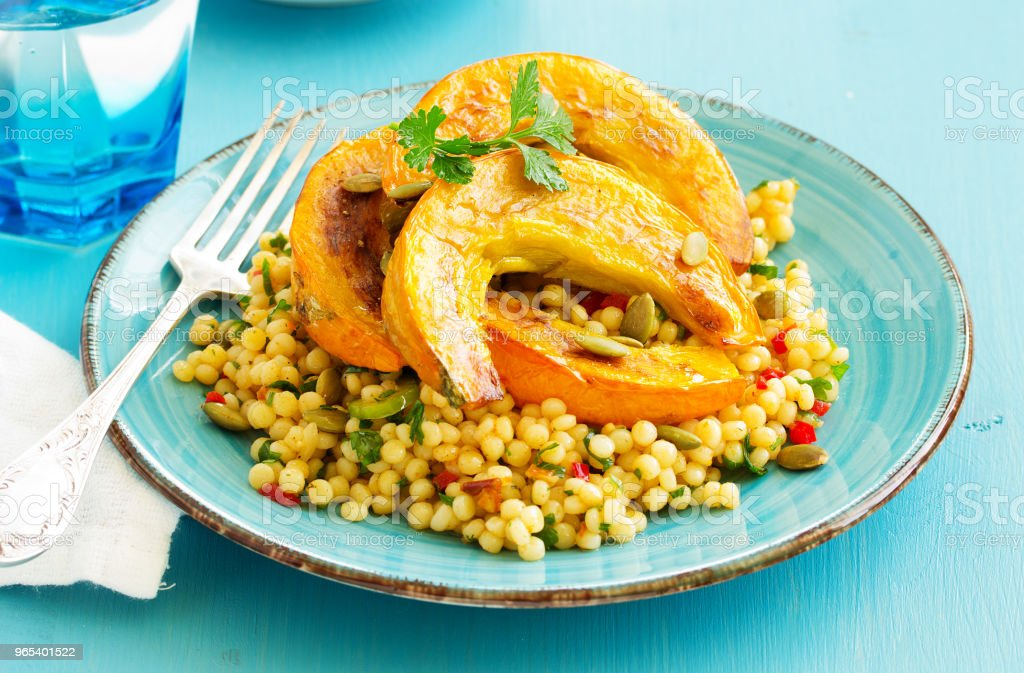 Baked pumpkin stuffed with salad from bulgur. zbiór zdjęć royalty-free