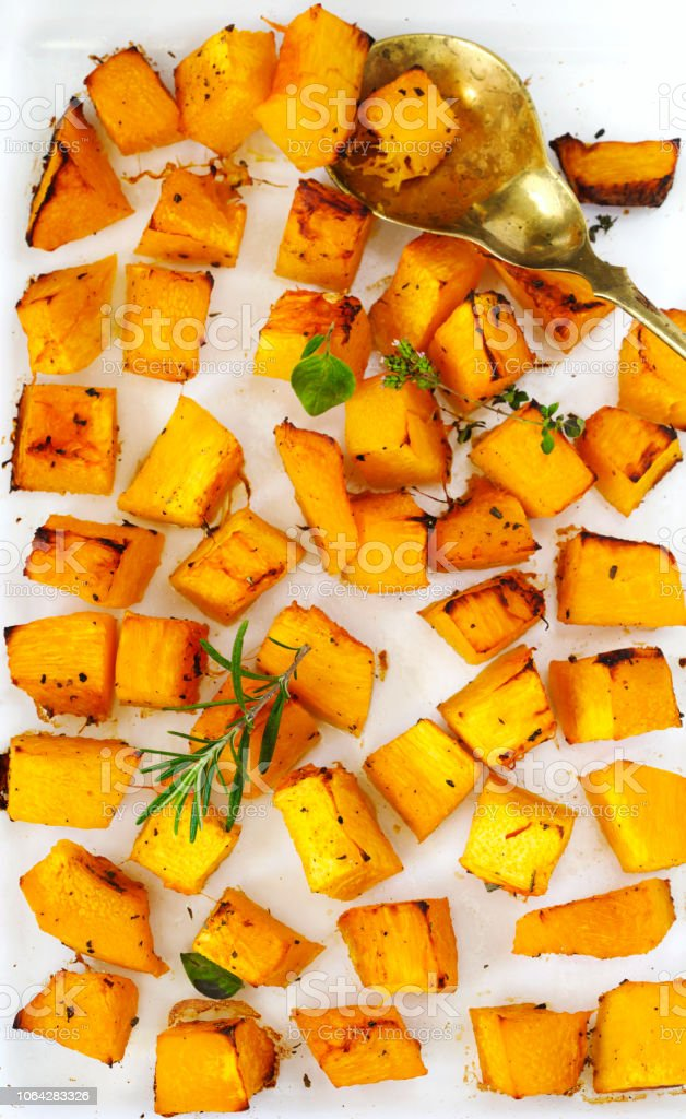 Baked pumpkin with herbs stock photo
