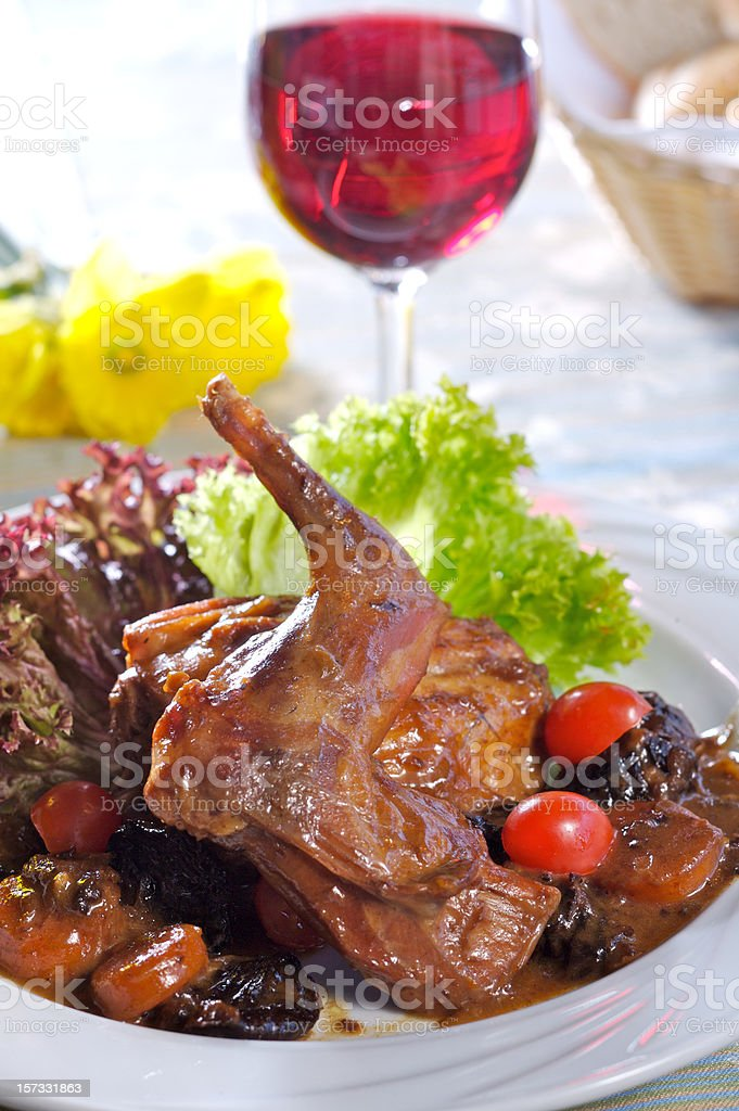 Baked rabbit with plums stock photo