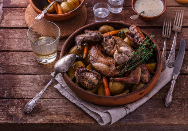 Baked rabbit with potato and carrots, top view stock photo