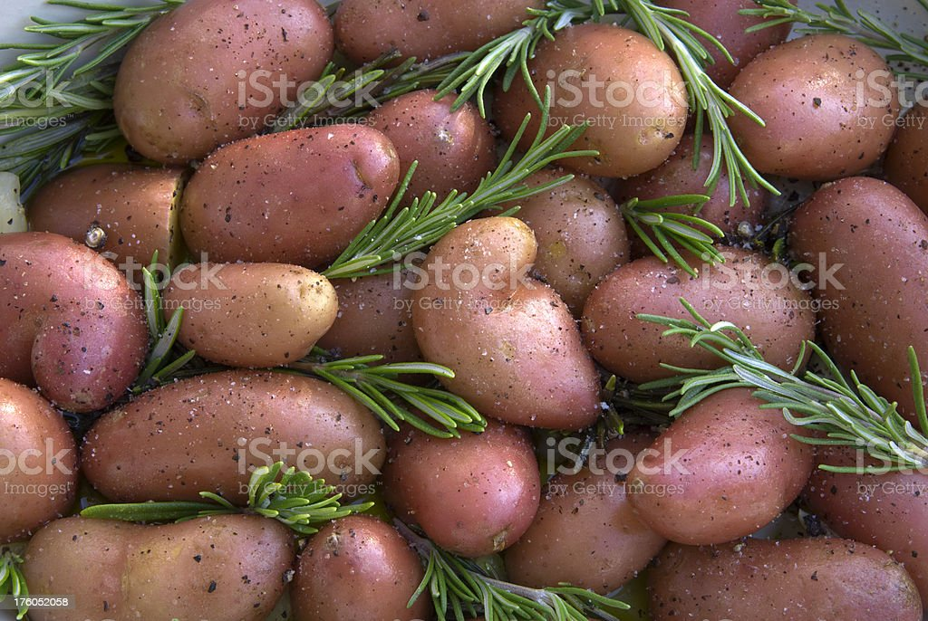 Baked Red Fingerling Potatoes & Fresh Rosemary Side Dish Background stock photo