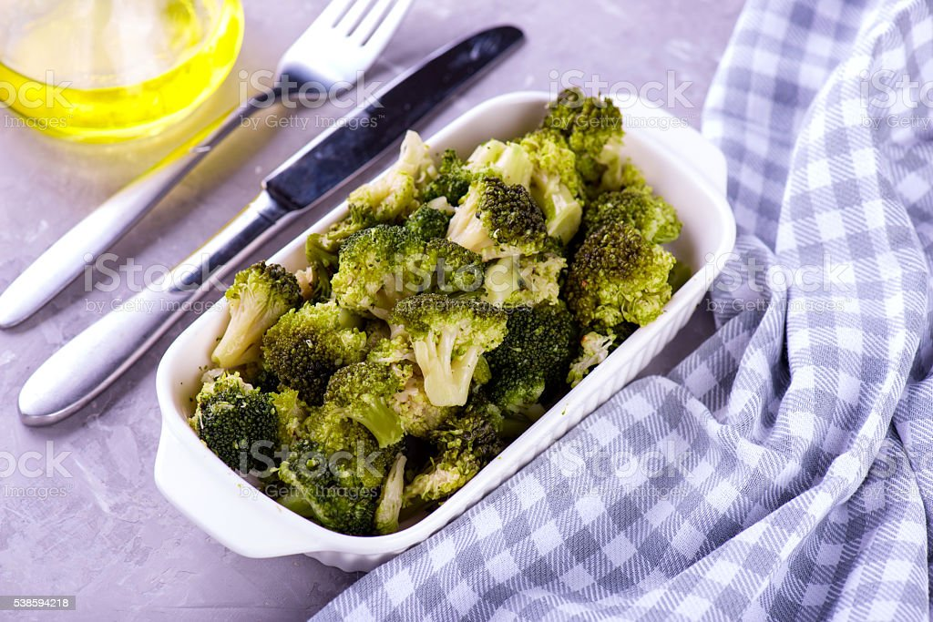 baked roasted garlic parmesan and olive oil broccoli stock photo