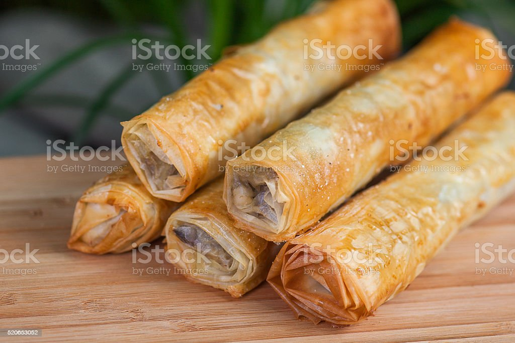 baked roll of phyllo dough, with a filling stock photo