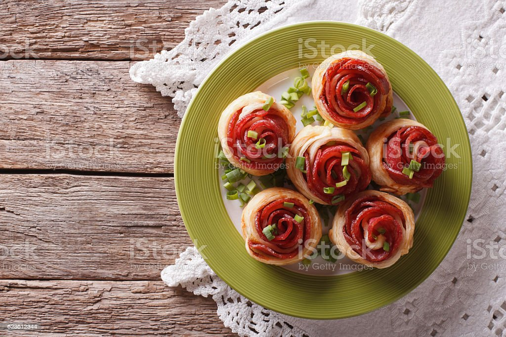 Baked rolls with salami in the form of roses. horizontal stock photo