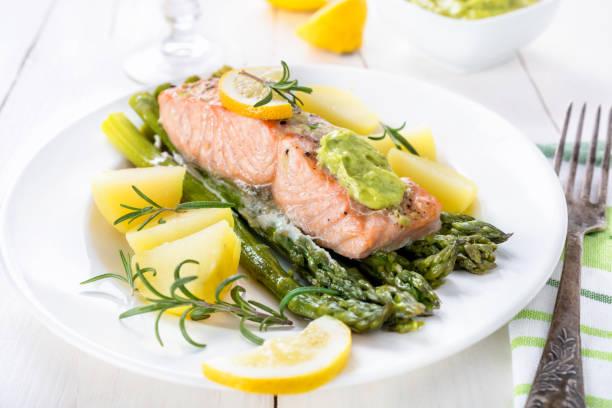 Baked salmon and asparagus with wild garlic mayonnaise stock photo