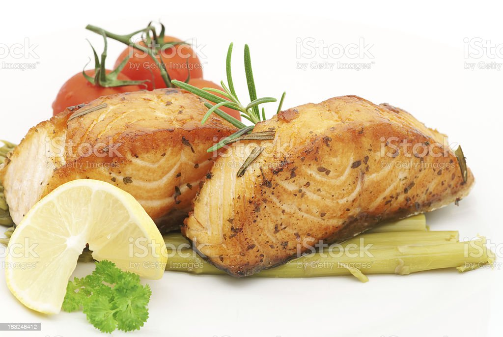 Baked salmon fillet with rosemary and asparagus- closeup royalty-free stock photo