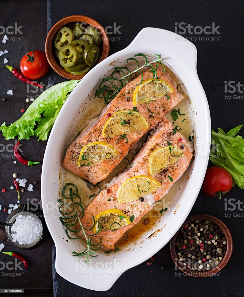 Baked salmon fillet with rosemary, lemon and honey stock photo