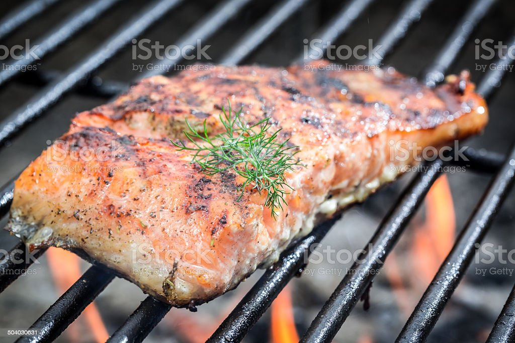 Baked salmon on the grill with fire stock photo