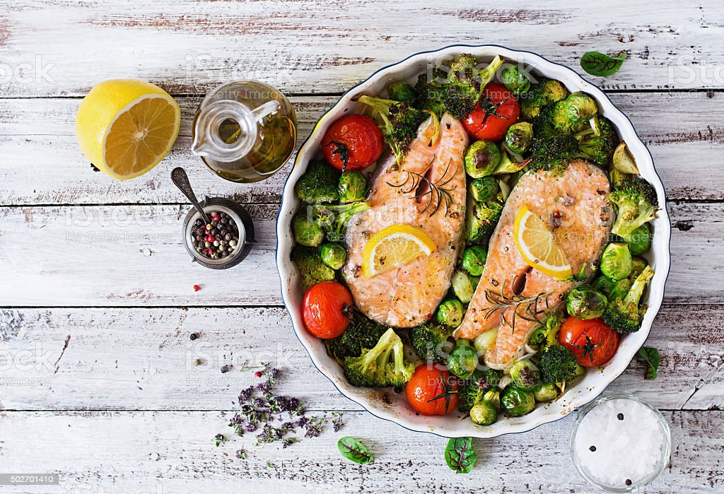 Baked salmon steak with vegetables. Diet menu. Top view stock photo