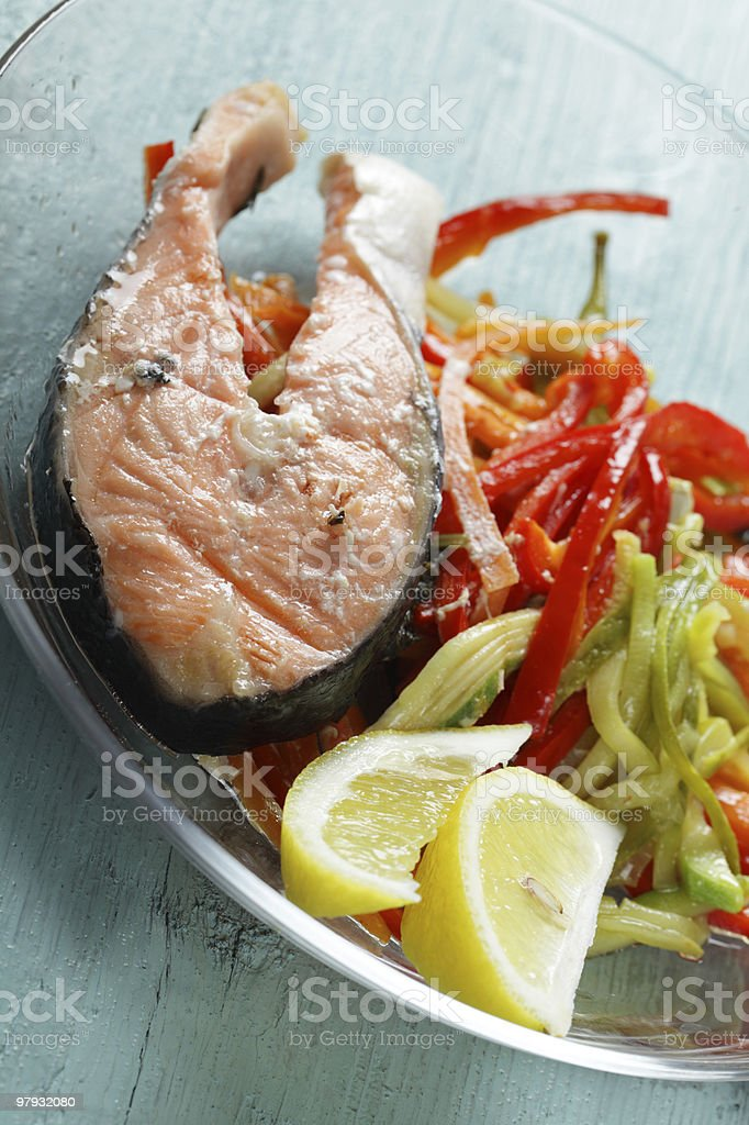 Baked salmon steak with vegetables royalty-free stock photo