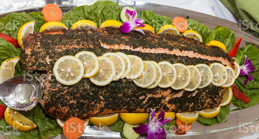 Baked salmon with basil and lemon stock photo