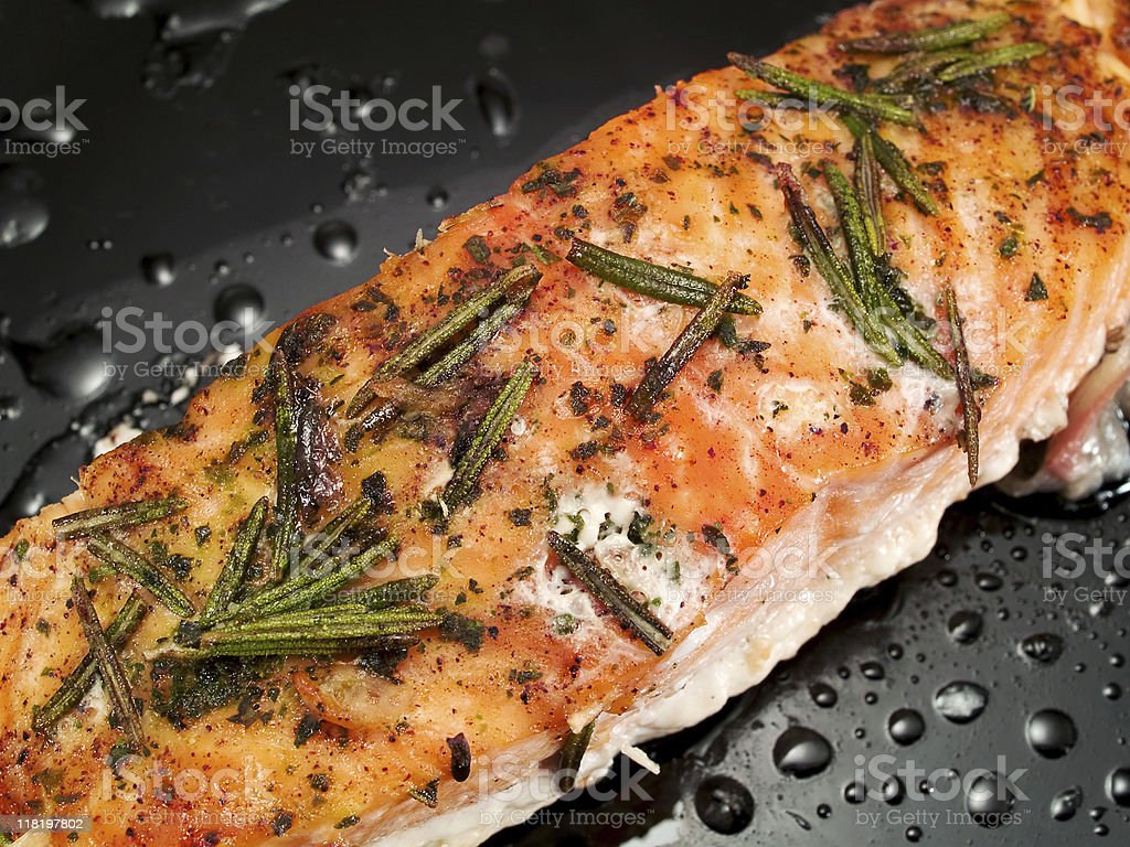 Baked salmon with rosemary royalty-free stock photo