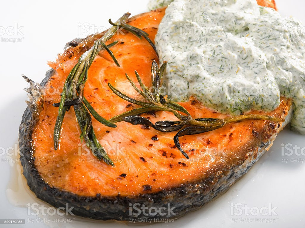 Baked salmon with sauce stock photo