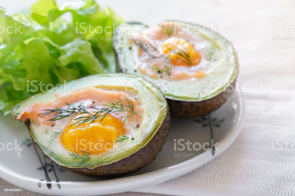 Baked smoked salmon, egg in avodaco, ketogenic keto low carb diet food royalty-free stock photo