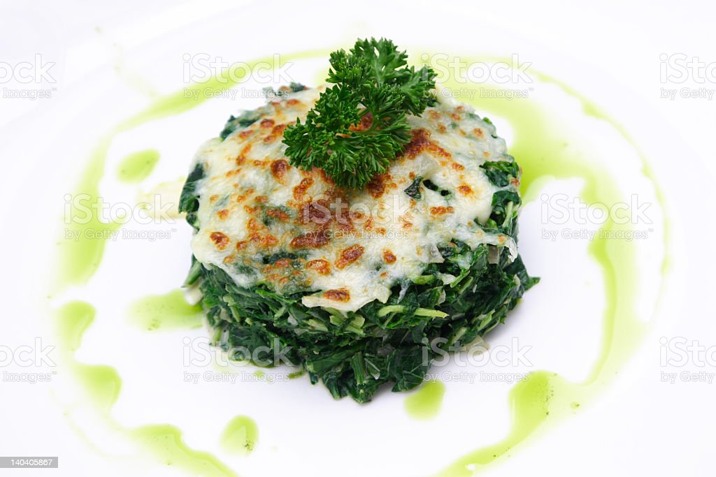Baked spinach with cheese on top royalty-free stock photo