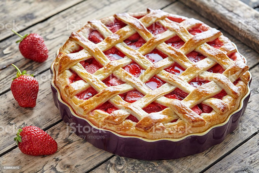 Baked strawberry pie cake sweet pastry on rustic table stock photo