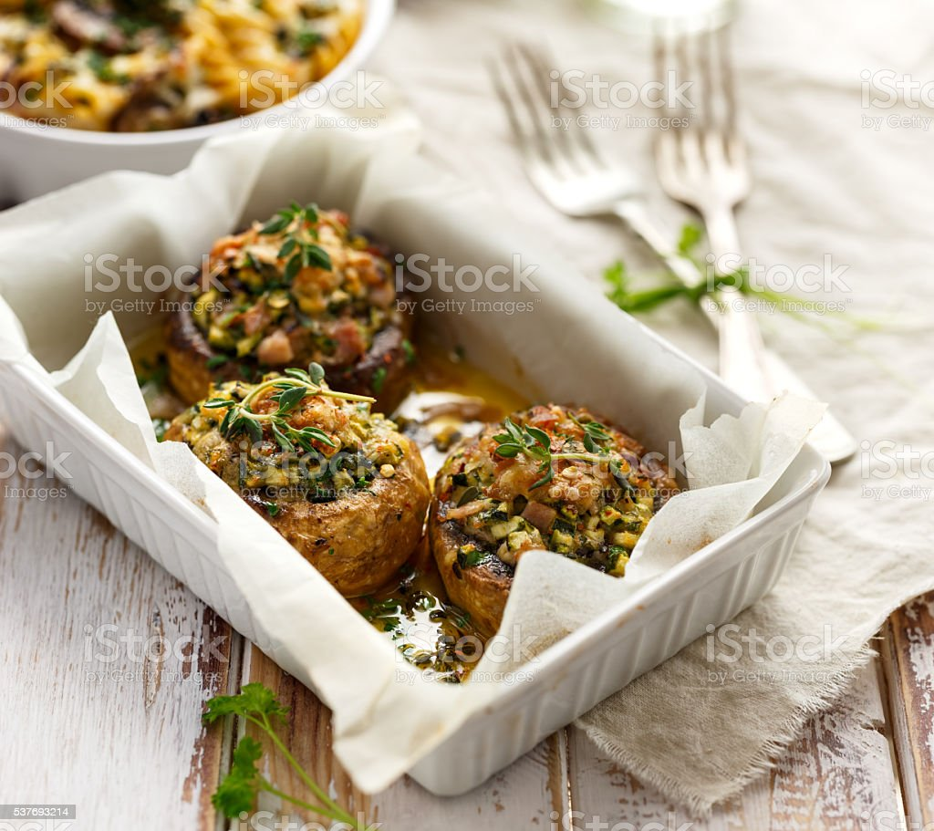 Baked stuffed mushrooms stock photo