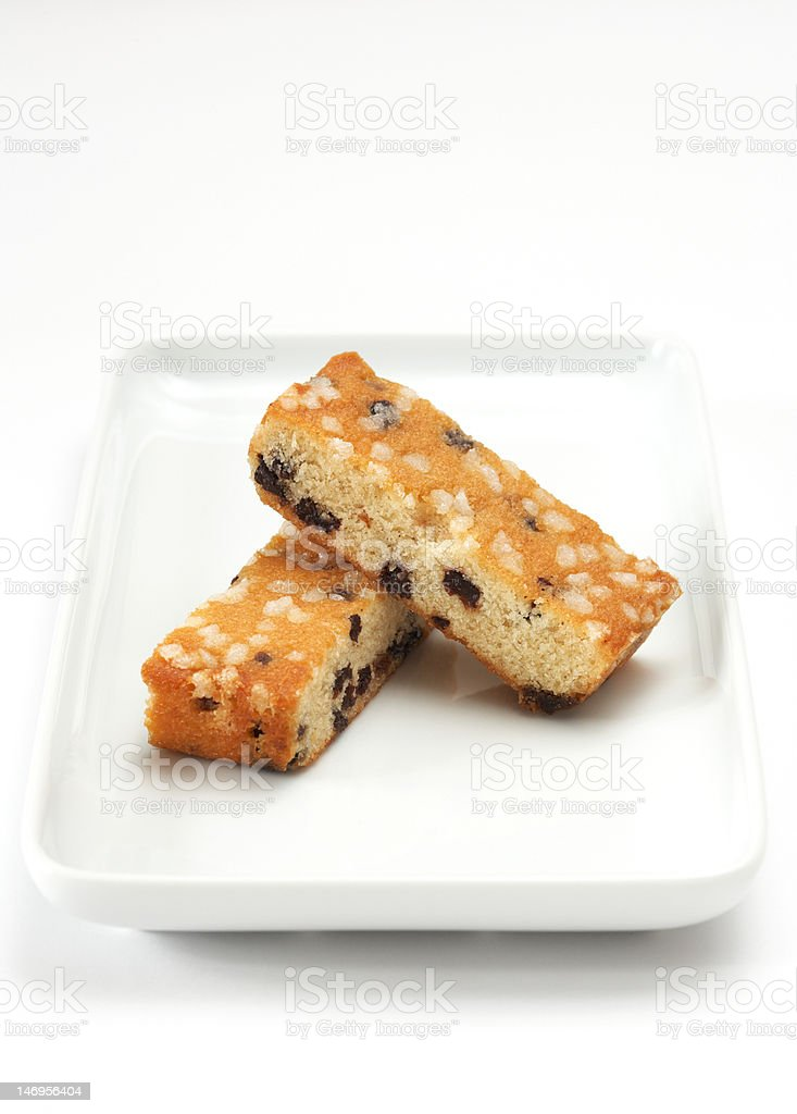 Baked sultana cakes topped with sugar nibs royalty-free stock photo