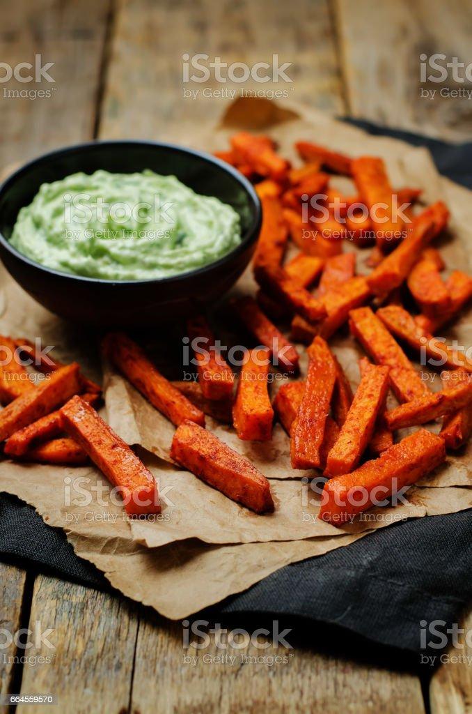 Baked Sweet Potato Fries with Avocado greek yogurt lime cilantro dip stock photo