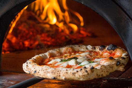baked tasty margerita pizza near oven