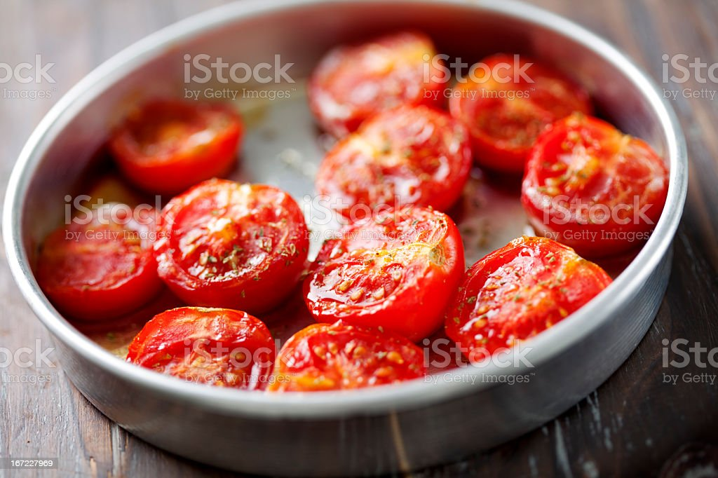 Baked tomato halves in small pan stock photo