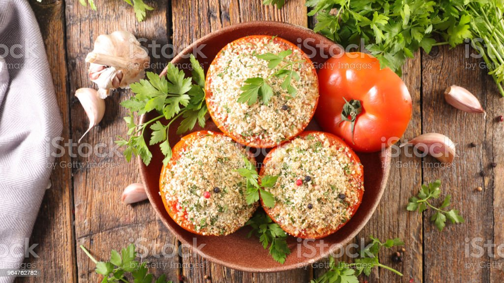 baked tomato with garlic and parsley royalty-free stock photo