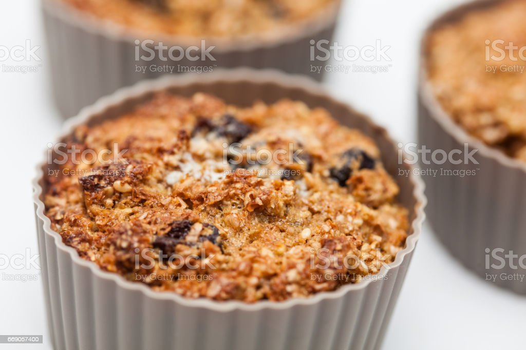 Baked wheat bran muffins in a silicone baking cup stock photo