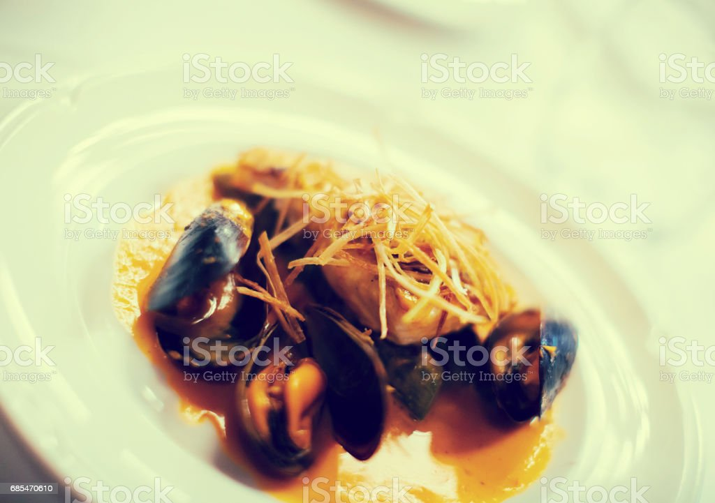 baked white fish with mussels foto de stock royalty-free