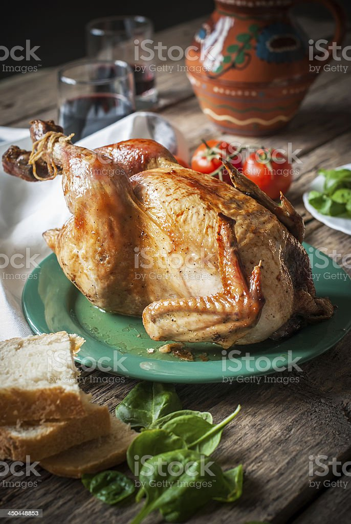 Baked Whole Chicken with fresh vegetables for dinner, selective stock photo