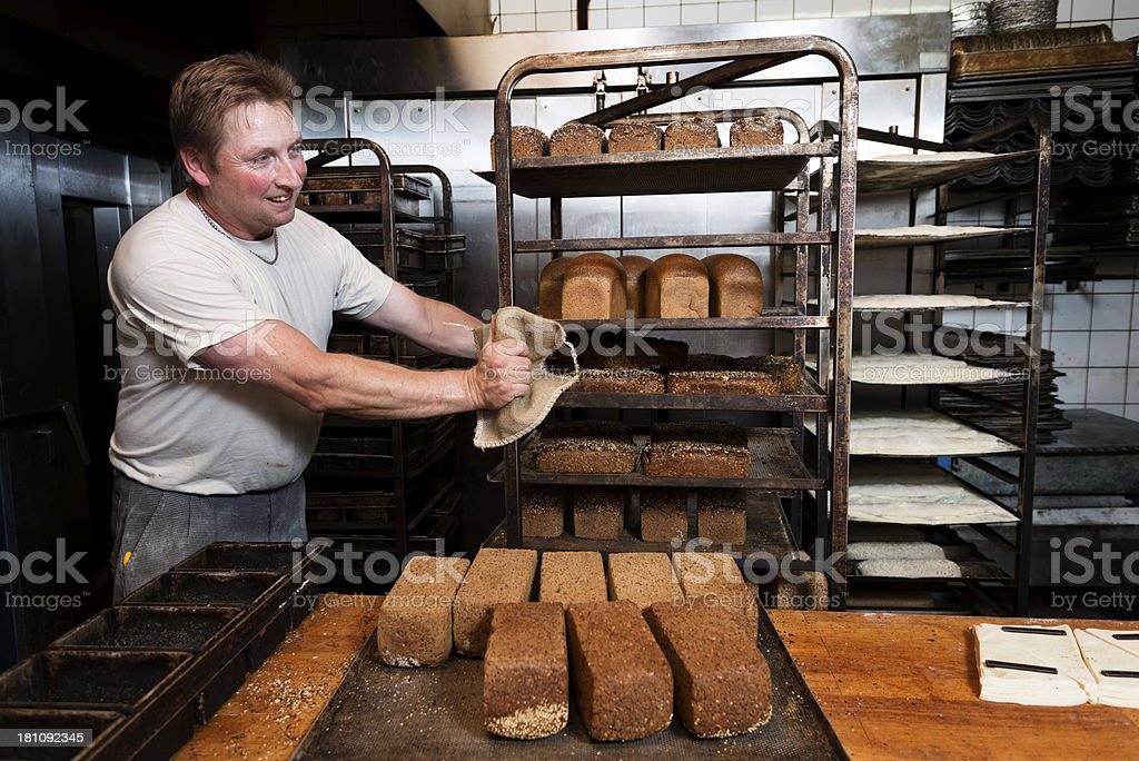 Baker At Work In His Bakery stock photo