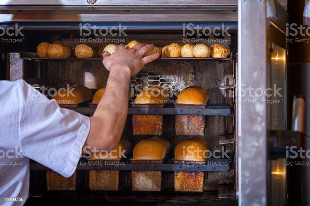 Baker bakes bread stock photo