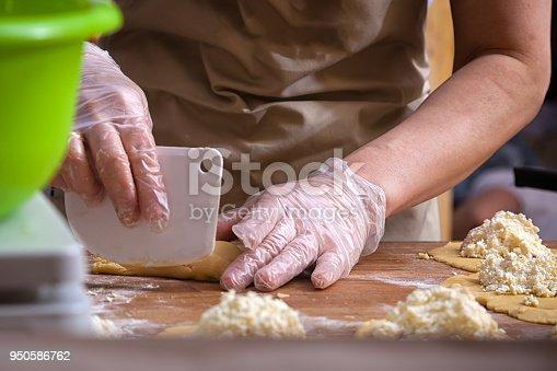 istock Baker cooking buns 950586762