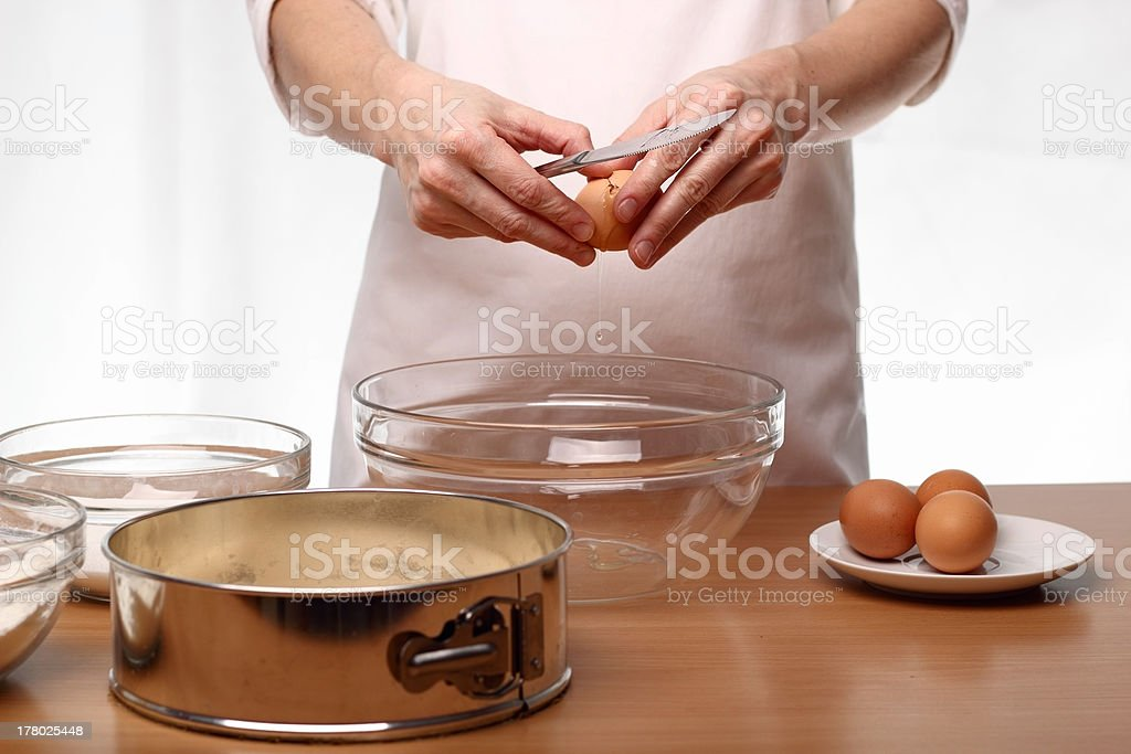 Baker cracking an egg royalty-free stock photo