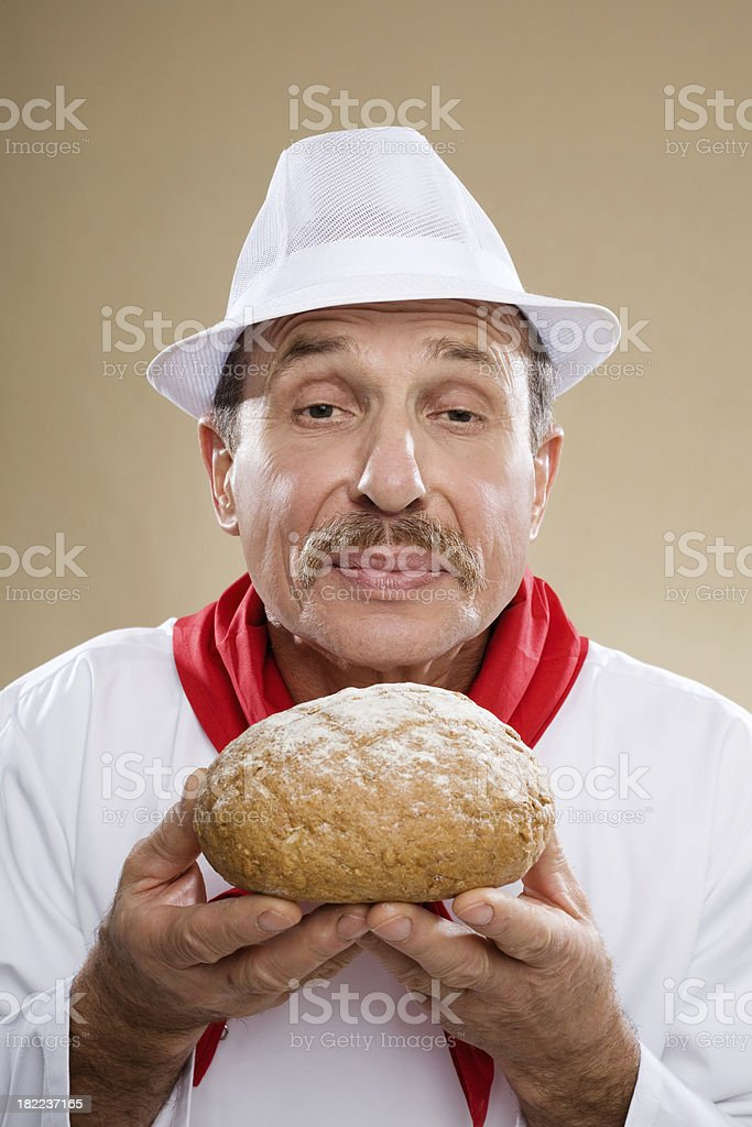 Baker Holding Loaf Of Bread royalty-free stock photo