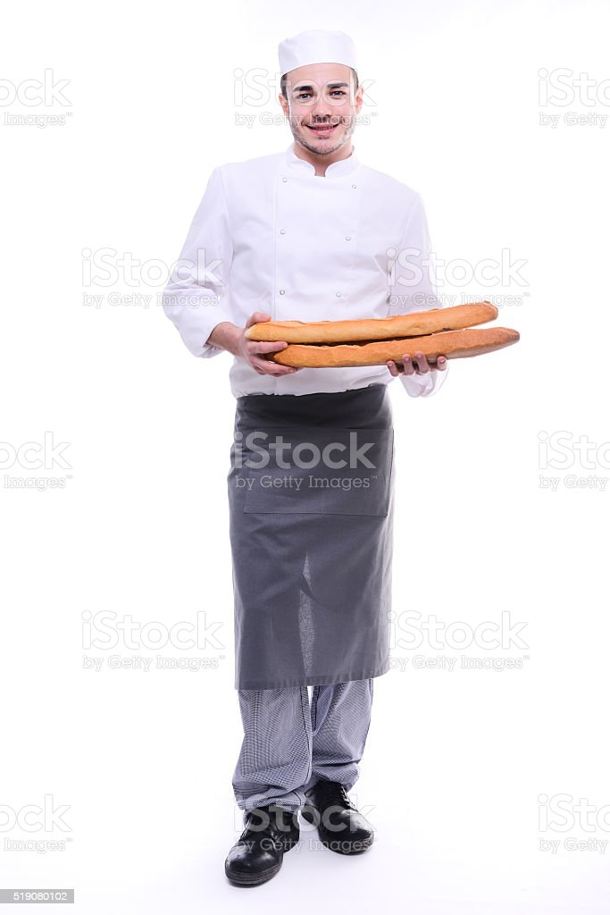 baker isolated white studio background holding traditional bread french baguettes stock photo