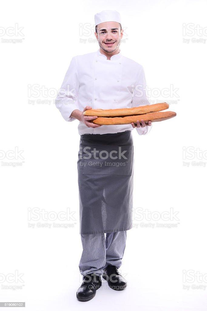 padeiro isolado fundo branco Studio segurando tradicional pão francês baguetes - fotografia de stock